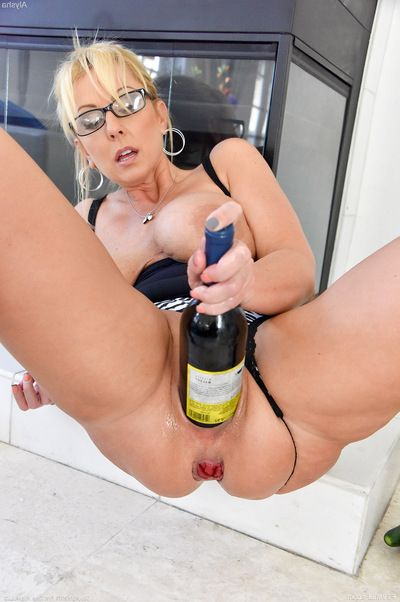 Buxom blond MILF swells gentile for large phallus exchanger and bottle insertions