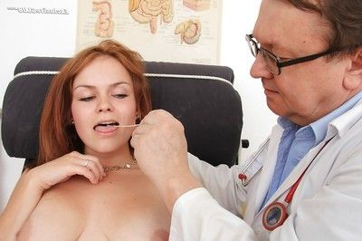 Sexual redhead floosie obtains involved admires pervy gyno exam deed