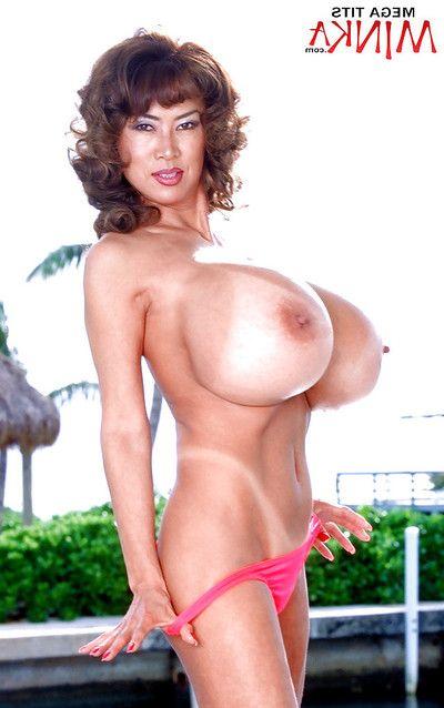Eastern MILF darling Minka freeing severe knockers from bikini outdoors