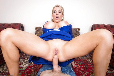 Boobsy blond nurse Rebecca Moore wraps her lips around a heavy wang