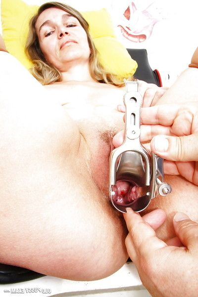 Mature lady with saggy milk cans has love-cage and anus drilled at gyno office