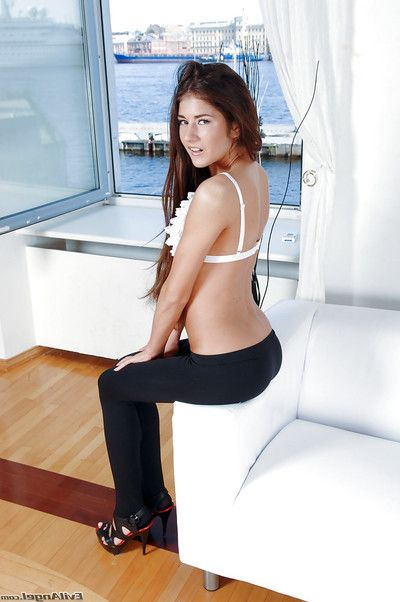 Foxy gal in yoga shorts removes clothes down and has some anal toying liking