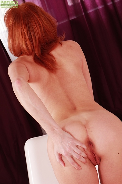 Senior redhead Bachova flaunting spot on target shoestring masked matured botheration