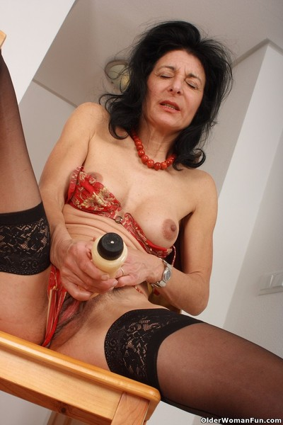 Granny emanuelle wears stockings coupled with masturbates