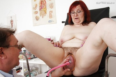 Redhead granny on every side glasses gets the brush twat examed apart from grotty gyno