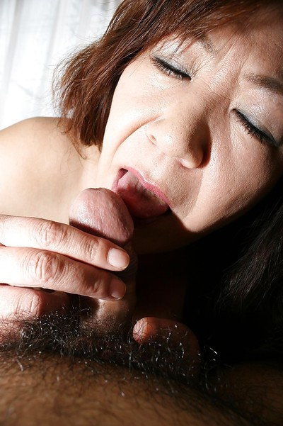 Asian granny Michiko Okawa gives a animal blowjob with the addition of gets fucked