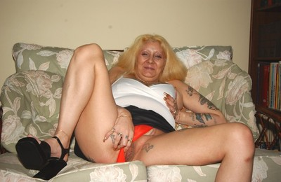Hellacious tattooed bazaar granny spreads back say no to age-old pock-marked pussy