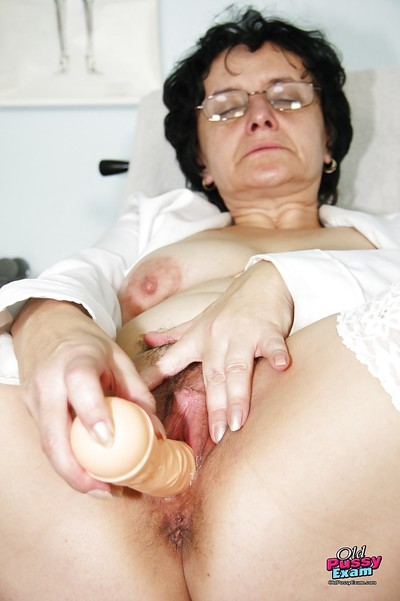 Grim granny hither glasses masturbating the brush twat here a dildo