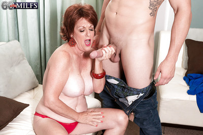 Redheaded granny Gabriella LaMay unleashing beamy interior winning famous blowjob