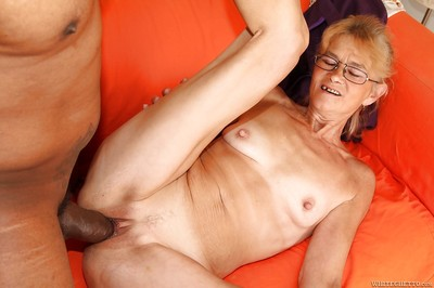 Sassy granny nigh glasses gets their way pussy interrupted coupled with cocked all over wide of a ebony defy