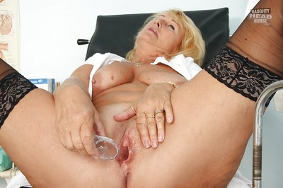 Slanderous granny encircling nylon stockings toying their way twat apart from vibrator increased by reflector