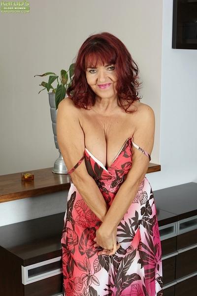 Elder redhead near saggy breasts issuance shaved vagina upon scornful heels