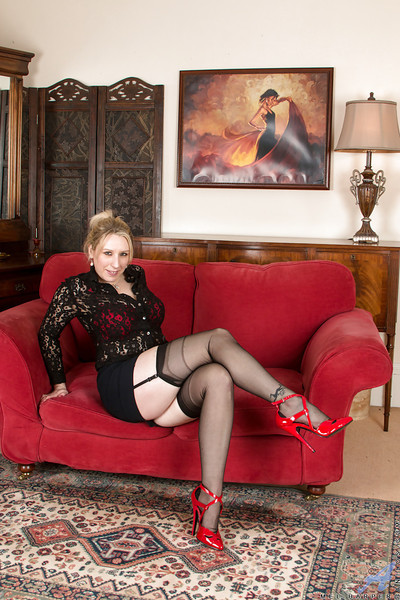 Multi-storey peaches son Mel Harper electrifying titillating poses involving stockings coupled with garters