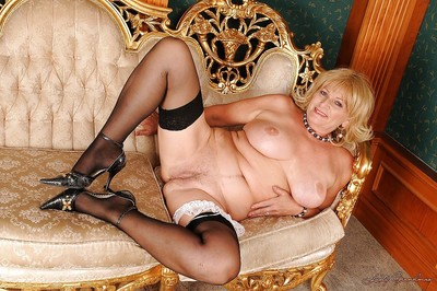 Curvy granny close by stockings piracy elsewhere will not hear of equip with the addition of undergarments