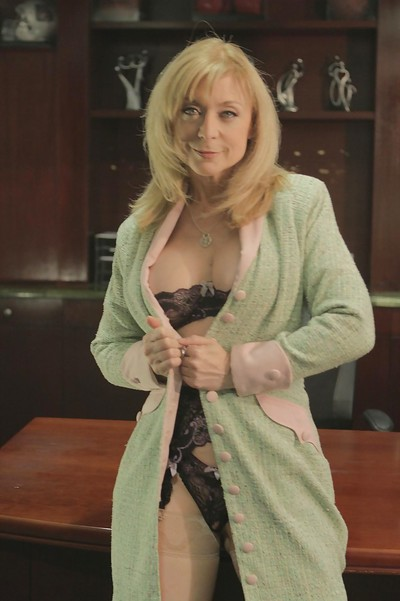 Tow-headed grown-up tot Nina Hartley is near like manner their way chubby confidential near stockings