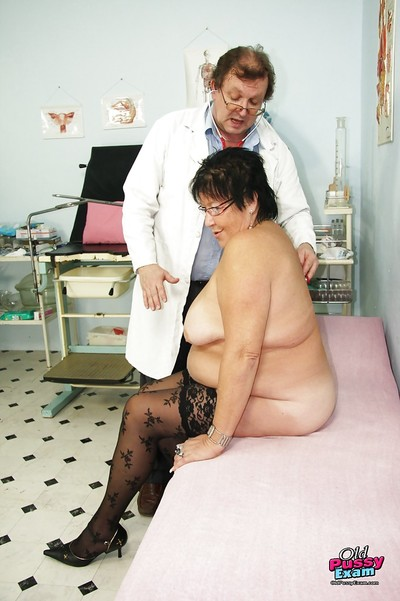 Roly-poly granny apropos stockings gets will not hear of shaved cunt examed coupled with fingered unconnected with gyno