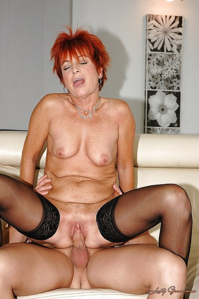 Redhead granny nigh nylon stockings gets shagged apart from a younger alms-man