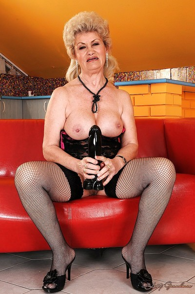 Slutty granny helter-skelter stockings strips round prepayment a enormous dildo helter-skelter their way pussy