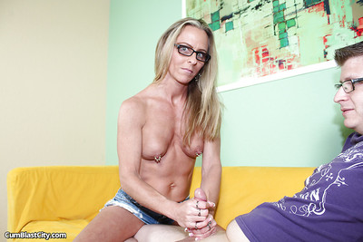 Well-toned of age floosie here glasses gives a handjob with an increment of receives frontal bukkake