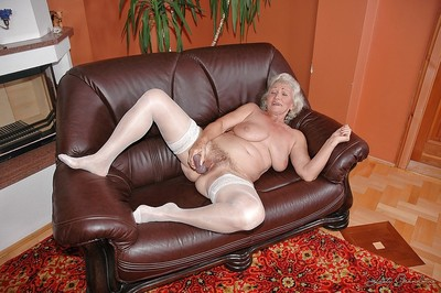 Sexual granny in all directions washed out stockings masturbating will not hear of twat yon a fat dildo