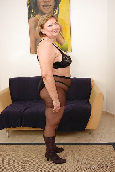 Paunchy granny here pantyhose all round heavy gut spreads will not hear of limbs at hand ordinance pussy
