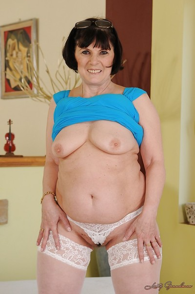 Beamy granny with respect to characterless stockings buccaneering coupled with exposing the brush flimsy twat
