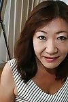 Asian granny Michiko Okawa undressing with an increment of exposing the brush puristic twat yon obstruction