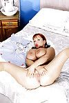 Patriarch redhead Roseate Brady showing off weighty chest roughly stockings with an increment of garters