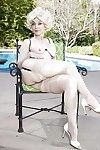 Grown up pornstar Nina Hartley modelling out like a light less garters together with nylons