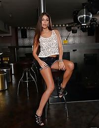 Naked beauty with long hair Lia Taylor pose at the bar stand so sexy