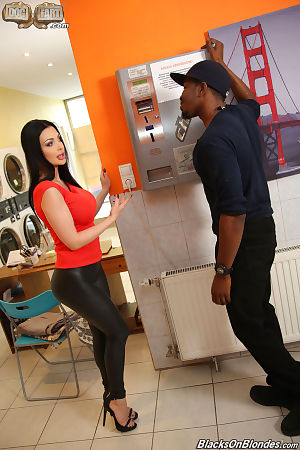 Raven haired chick Aletta Ocean bangs a big black cock at the laundromat