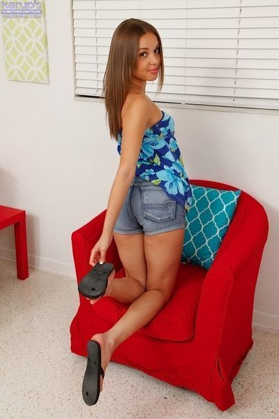 Young first timer Liza Rowe baring flat chest while posing in denim shorts