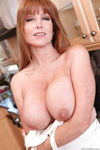 Redhead mature vixen reveals her huge tits and exposes them in close up