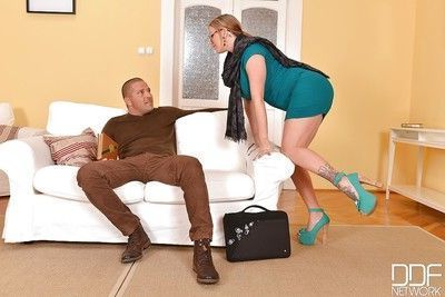 Foot fetish scene with a tattooed girl with long legs Yuffie Yulan doing footjob