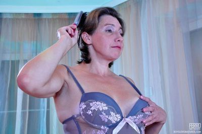 Dolled-up mature in a bustier and nylons gets her fix of loaded young meat