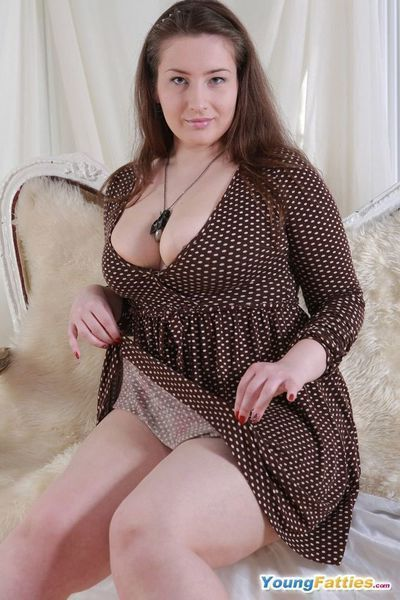 Cute fat brunette gets rid of her lingerie