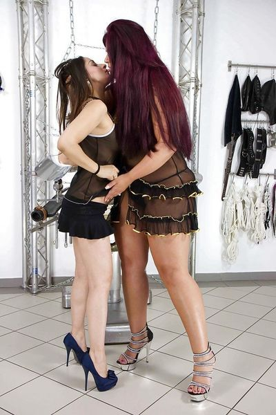 Amateur lesbians Cora Kitty and Lolita licking pussy before strapon fucking