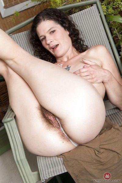 Mature hirsute model Sunshine baring tits and hairy underarms