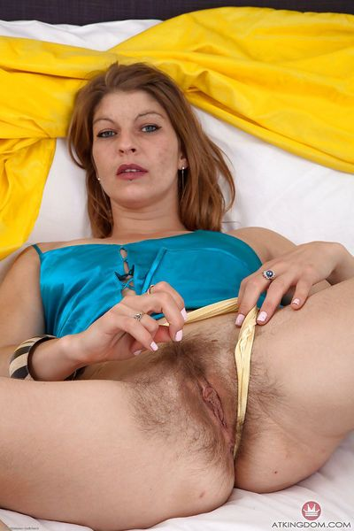 Older hairy model with furry armpits slides panties aside to reveal beaver