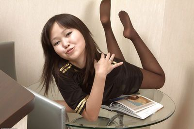 Asian babe Alexa is busy with spreading her chubby vulvar lips