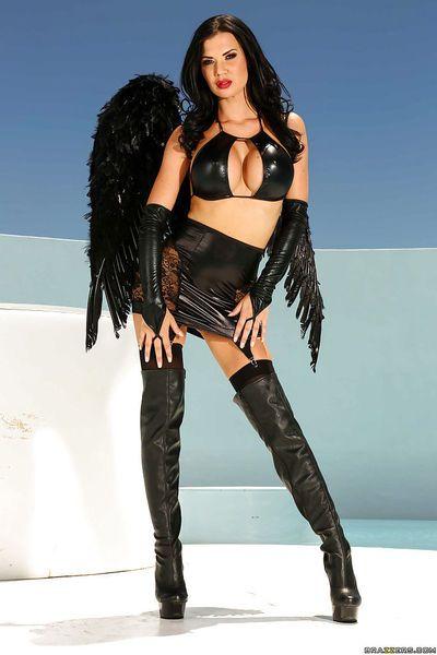 Bog boobed Angel Jasmine Jae strutting in thigh high boots and garters