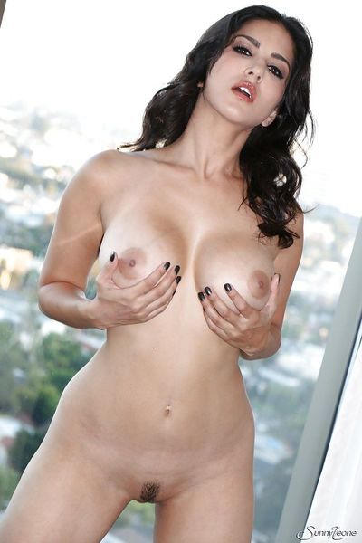 Curly-haired brunette Sunny Leone is playing with her anal toys