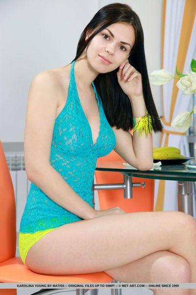 Cute teen Karolina Young removes lace panties to show pink pussy closeup
