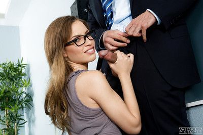Petite pornstar Natasha White gobbling fat cock in glasses
