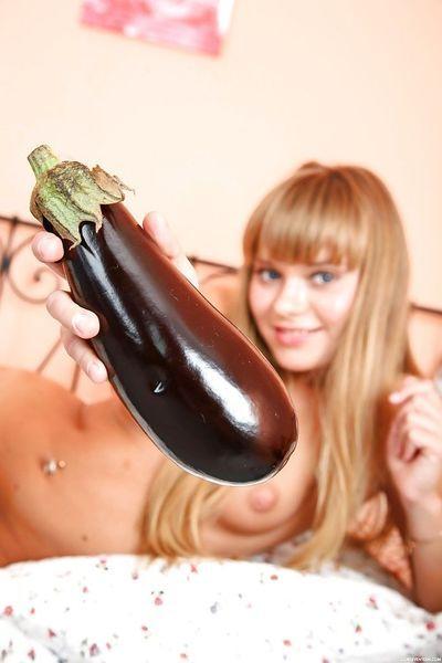 Barely legal Euro cutie Jessy B masturbates bald cunt with veggie insertion