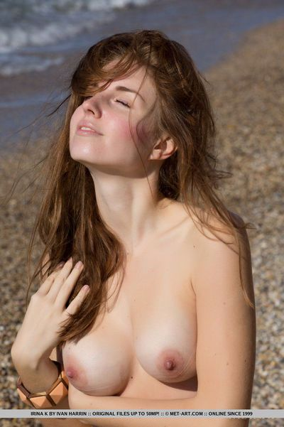 Brunette Irina K shows big nipples & hot trimmed pussy at beach in bare feet