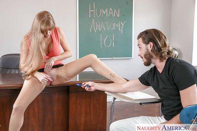 Mature teacher Darla Crane giving her male student oral sex in classroom