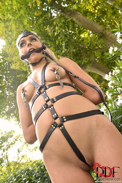 Blonde babe Chloe Toy is restrained outdoors with pony bit gag in mouth