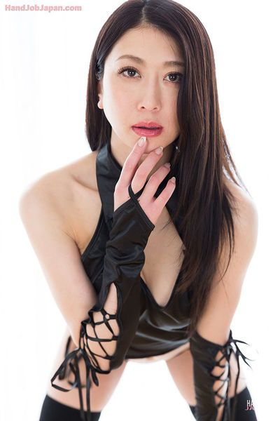 Japanese chick in thigh high socks & long gloves eats cum after giving handjob