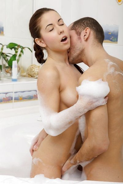 Hot teen babe Lisa I performing fellatio on boyfriend in the bathtub